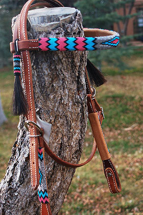 A horse wearing a custom beaded headstall from The Brown Cow Saddle Blanket Company.
