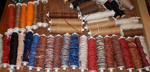 spools of colored yarn and threads in the brown cow saddle blanket studio