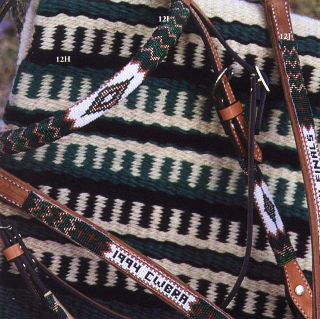 hand-beaded headstalls with awards written into the beadwork